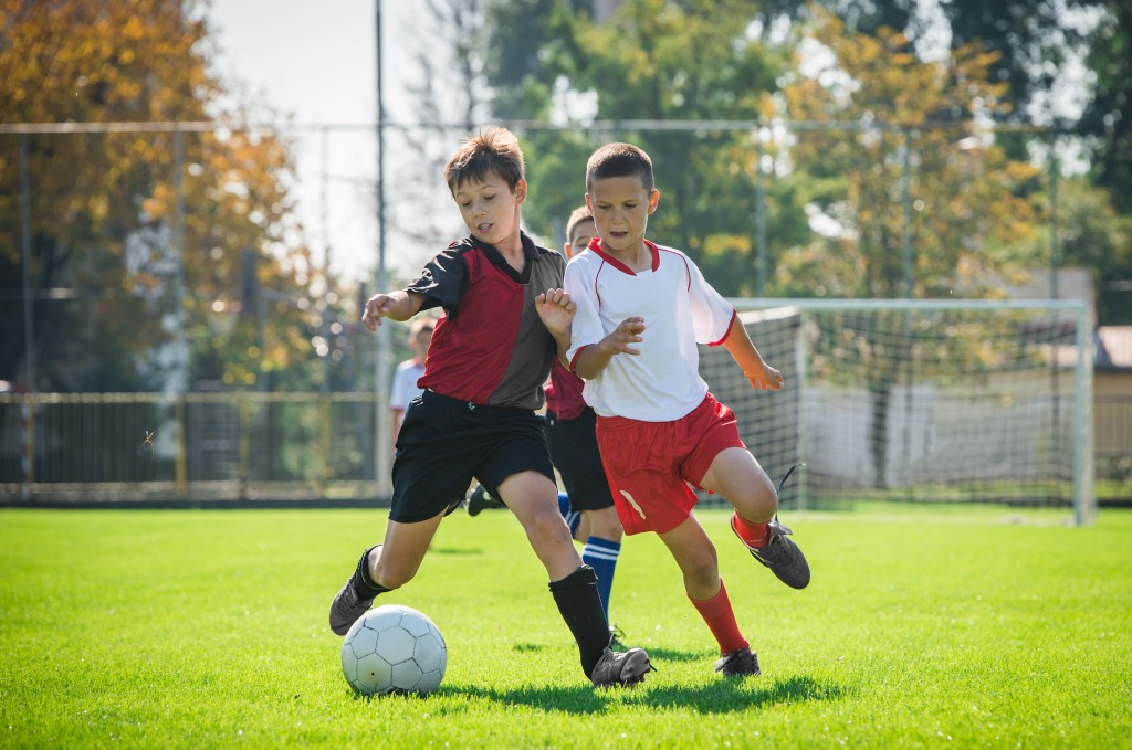 How Football Fosters Positive Values in Kids