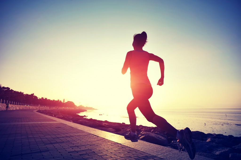 athlete running during sunrise