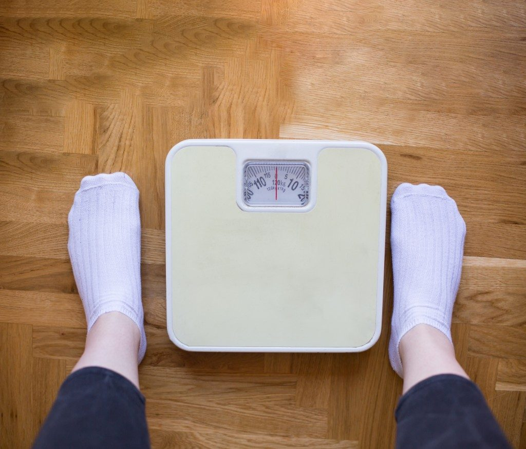 Weighing scale in front of a person