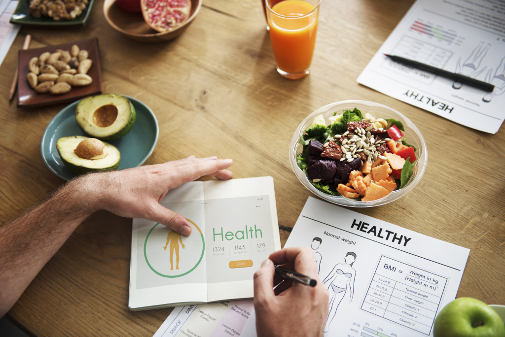 a person with a checklist and healthy food